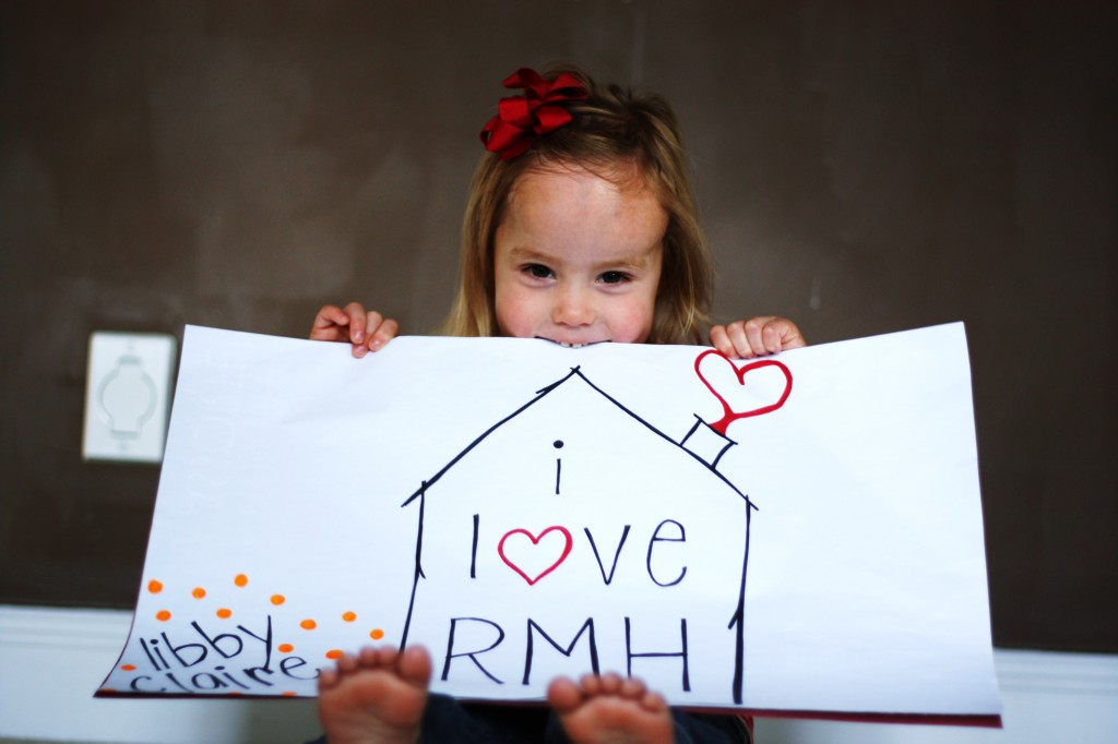 "Little girl holding a ""I love RMH"" poster"