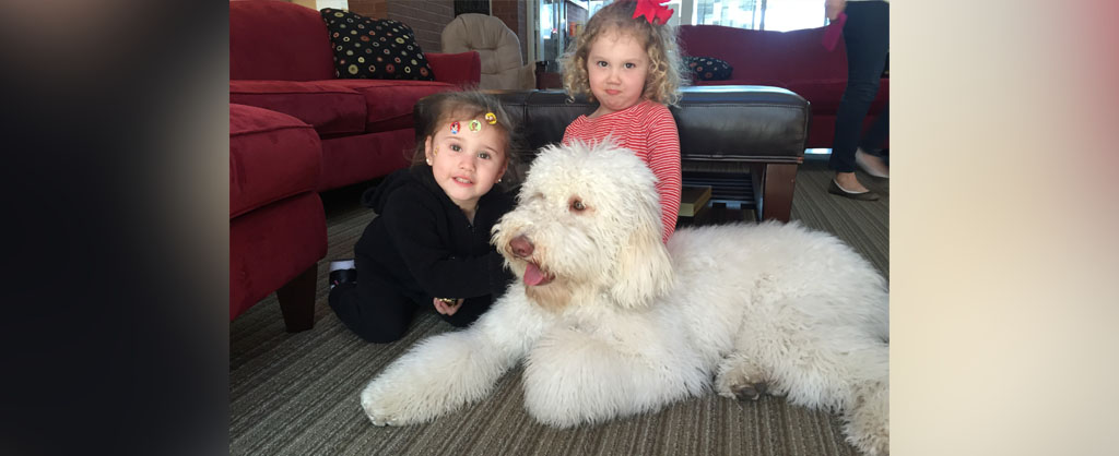Siblings with Willow the therapy dog